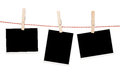 Blank photos hanging on clothesline Royalty Free Stock Photo