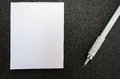 Blank post it paper book with pencil, on black sandpaper texture Royalty Free Stock Photo