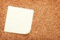 Blank postit note on cork wood notice board Royalty Free Stock Photo