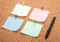 Blank postit notes on cork notice board Royalty Free Stock Image