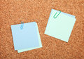 Blank postit notes on cork notice board wood Stock Image
