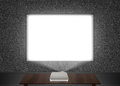 Blank projector screen mockup on the wall. Royalty Free Stock Photo