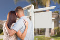 Blank Real Estate Sign and Military Couple Looking at House