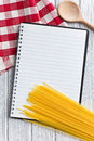 Blank recipe book with italian spaghetti Royalty Free Stock Photos