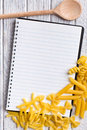 Blank recipe book with various pasta Stock Image