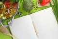 Blank recipe book with vegetable soup kitchen equipment and veggies around them Royalty Free Stock Image