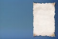 Blank recycled paper on blue background. Royalty Free Stock Images