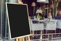 Blank restaurant menu blackboard with blury people Royalty Free Stock Photo