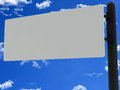 Blank road sign white isolated on sky background Royalty Free Stock Images