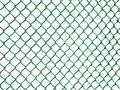 Blank rusty Metal Fence net mesh on dark green plain background Seamless Chainlink Fence Royalty Free Stock Photo