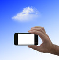 Blank screen smartphone in male hand and cloud on sky background Royalty Free Stock Photos