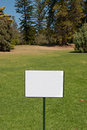 Blank sign in a garden on a bright sunny day Royalty Free Stock Photography