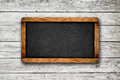 Blank Slate on Wooden Background Royalty Free Stock Photo