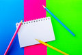 Blank spiral notepad and colorful pencils