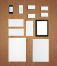 Blank stationery corporate id template set on wooden background consist of business cards folder tablet pc envelopes and smart Royalty Free Stock Photography