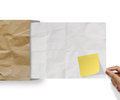Blank sticky note on recycle crumpled paper background texture in composition Stock Photos