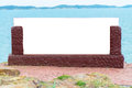 Blank stone sign near sea can be used for display or montage your products seascape and blue sky Stock Photos