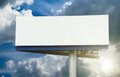 Blank street billboard on cloudy sky Royalty Free Stock Photo