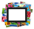 Blank tablet computer on heap of colorful photos Royalty Free Stock Photo