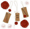 Blank tags tied with brown string and wax sealing. Stock Photos