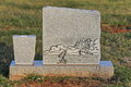 Blank tombstone with engraved fisherman granite catching a fish Royalty Free Stock Photos