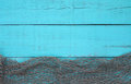 Blank turquoise aged wooden sign with fish net border Royalty Free Stock Photo