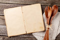 Blank vintage cooking book and utensils recipe top view with copy space Royalty Free Stock Image