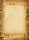 Blank vintage poster nailed on a wood board Royalty Free Stock Photo