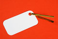 Blank white gift tag on a red textured background Royalty Free Stock Image