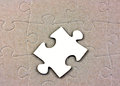 Blank white jigsaw piece on completed background Royalty Free Stock Photo