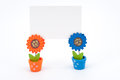 Blank white paper on clips of two sun flower pots Royalty Free Stock Photo