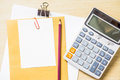 Blank white paper, pencil and calculator on desk Royalty Free Stock Photo