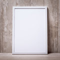 Blank white picture frame on the wall and the floor Royalty Free Stock Photo