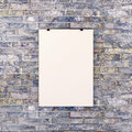Blank white poster on brick wall Royalty Free Stock Photo