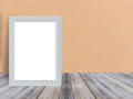 Blank white wooden photo frame at tropical plank wooden floor and wall. Royalty Free Stock Photo
