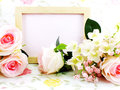 Blank wood frame ande pink roses with red velvet box on sweet background Royalty Free Stock Photo