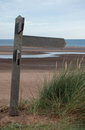 Blank wooden footpath sign on north norfolk coast pointing to the right the text could be added to the to portray a Royalty Free Stock Photos
