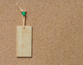 Blank wooden tag hang on cork board Royalty Free Stock Photo