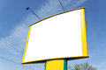 Blank yellow billboard over blue sky Stock Photos
