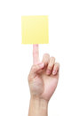 Blank yellow note on finger sticky a woman s isolated white background Royalty Free Stock Photography
