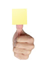 Blank yellow note on thumb sticky a man s isolated white background Stock Photo