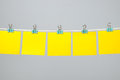 Blank yellow paper sheets on the string Royalty Free Stock Photo