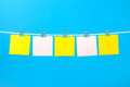 Blank yellow and pink paper notes on the string Royalty Free Stock Photo