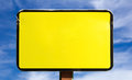 Blank Yellow Sign on a Blue Cloud Background Royalty Free Stock Photos