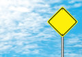 Blank yellow traffic sign on blue sky for text Stock Photo