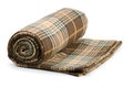 Blanket rolled plaid wool isolated on white Royalty Free Stock Photos