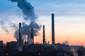 Blast furnace polluting the atmosphere on sunrise light in bucharest Royalty Free Stock Images