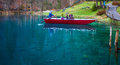 Blausee, Switzerland - Sightseeing In Red Boats Royalty Free Stock Photography