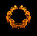 Blazing flames on black background circle of fire over Stock Photography