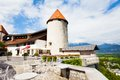 Bled castle inner yard with wall and tower slovenia Stock Photos